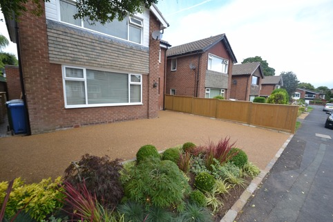 Resin bound gravel driving with planting in Bramhall