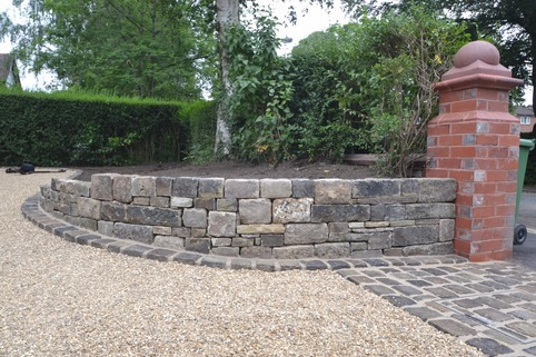 Stabilised Gravel driveway with dry stone wall and reclaimed setts for a rumble strip in Bramhall