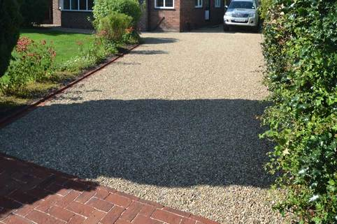 Stabilised Gravel driveway in Poynton with rumble strip and using clay block paving