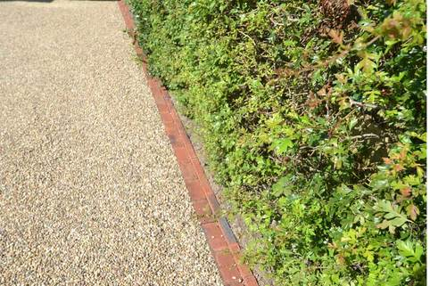Clay block paving edge of resin bound driveway